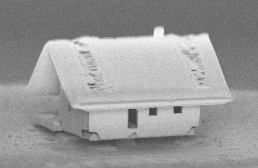 Robotic assembly of the world's smallest house—even a mite doesn't fit through the door