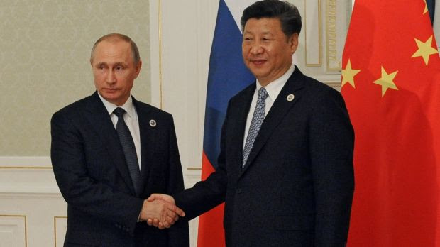 Chinese President Xi Jinping and Russian President Vladimir Putin at a meeting in June.