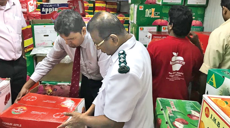 Colombo Municipal Council Medical officers seen conducting the raid.
