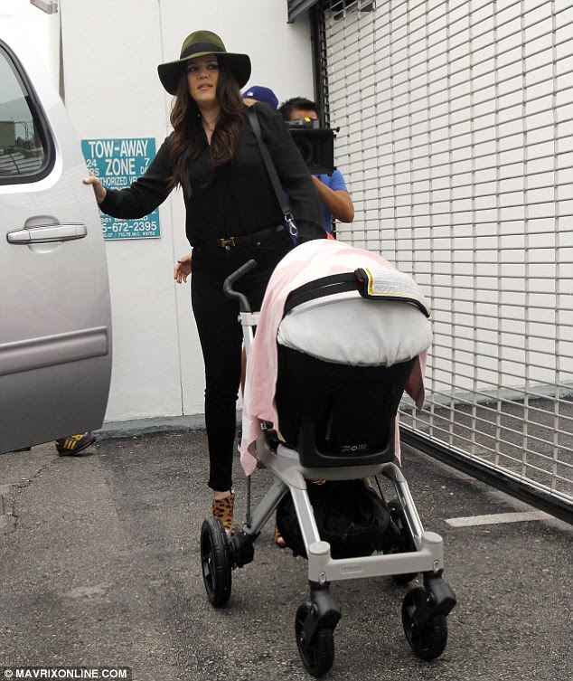And baby came too! Helpful Khloe pushes Kourtney's daughter Penelope in her stroller