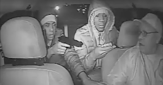 Chilling CCTV footage shows taxi driver being robbed at gunpoint by thugs who then asked to be DROPPED OFF