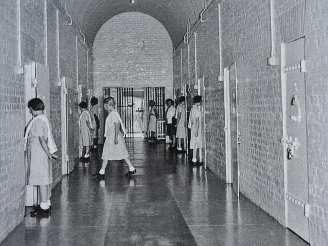 """""""Standing 'at ease' at our Cabin doors, waiting for our turn in the ablution parade."""" The"""