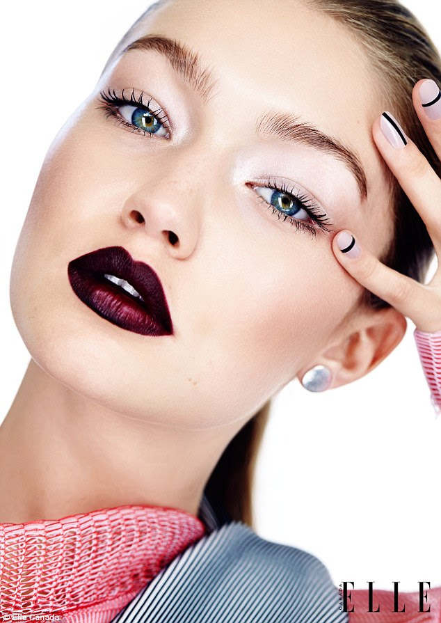 Close-up: Gigi is seen wearing burgundy lipstick and silver eye make-up in the spread