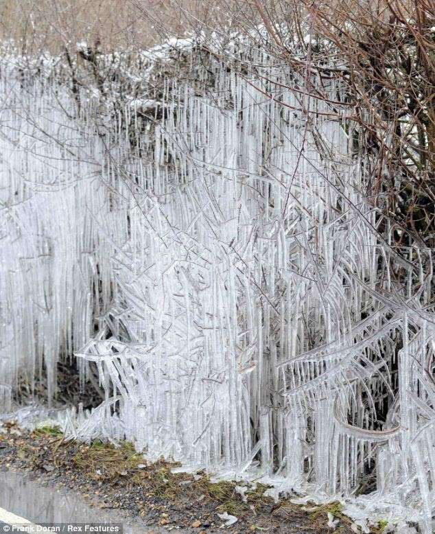 Rock solid: The icy scene shows just how cold Britain has become during the March freeze