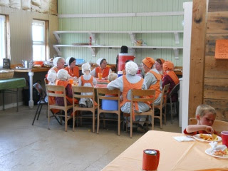 The Women Eating and Fellowshipping on The 12th Orange Day, 2012