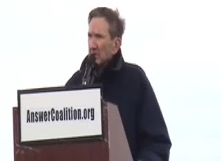 Photo: Ramsey Clark speaking at the recent demonstration