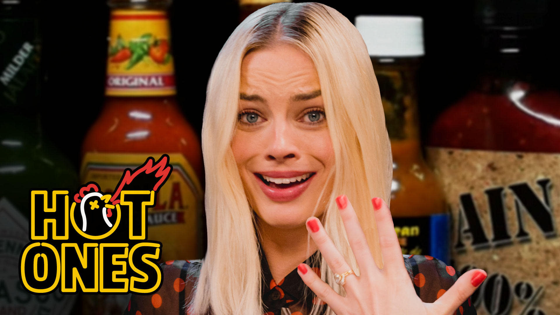 Margot Robbie Pushes Her Limits While Eating Spicy Wings Hot