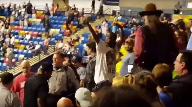 26-year-old Rakeem Jones was flipping the bird as he was being escorted out of a Donald Trump rally in North Carolina on Wednesday