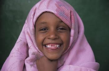 Somali girl laughing.