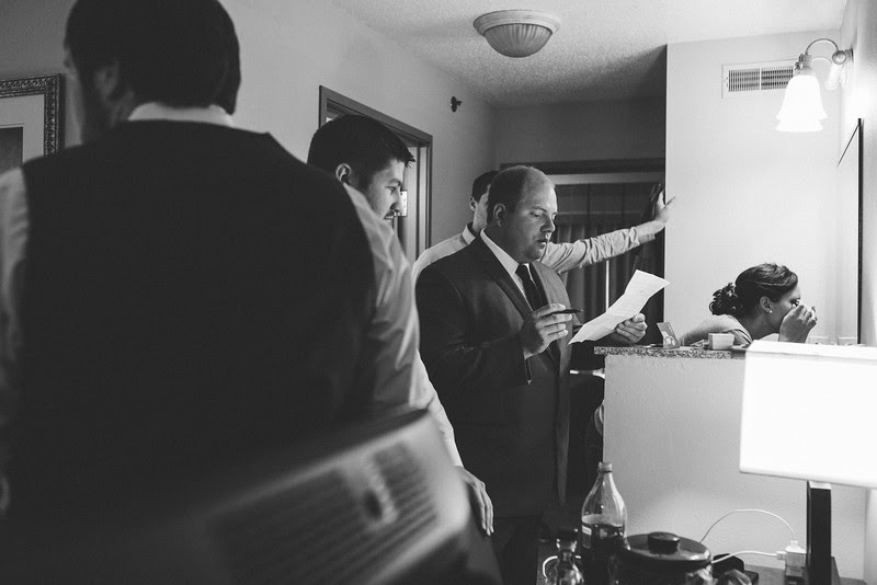 The Grom gets ready for his wedding day with his groomsmen and Man of Honor at a hotel first before heading Blumen Gardens Sycamore Illinois in early fall. The couple held an outdoor ceremony with the reception following indoors.
