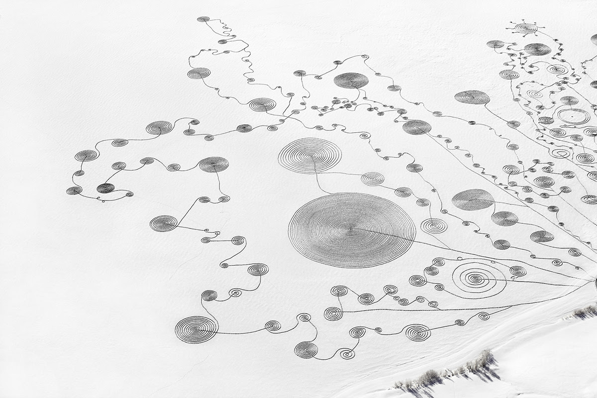 An Expansive Swirling Snow Drawing Atop a Frozen Lake by Sonja Hinrichsen snow land art lakes Colorado