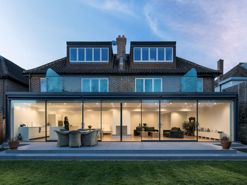 London Practice Joins Two Semi Detached Houses With Glazed Picture