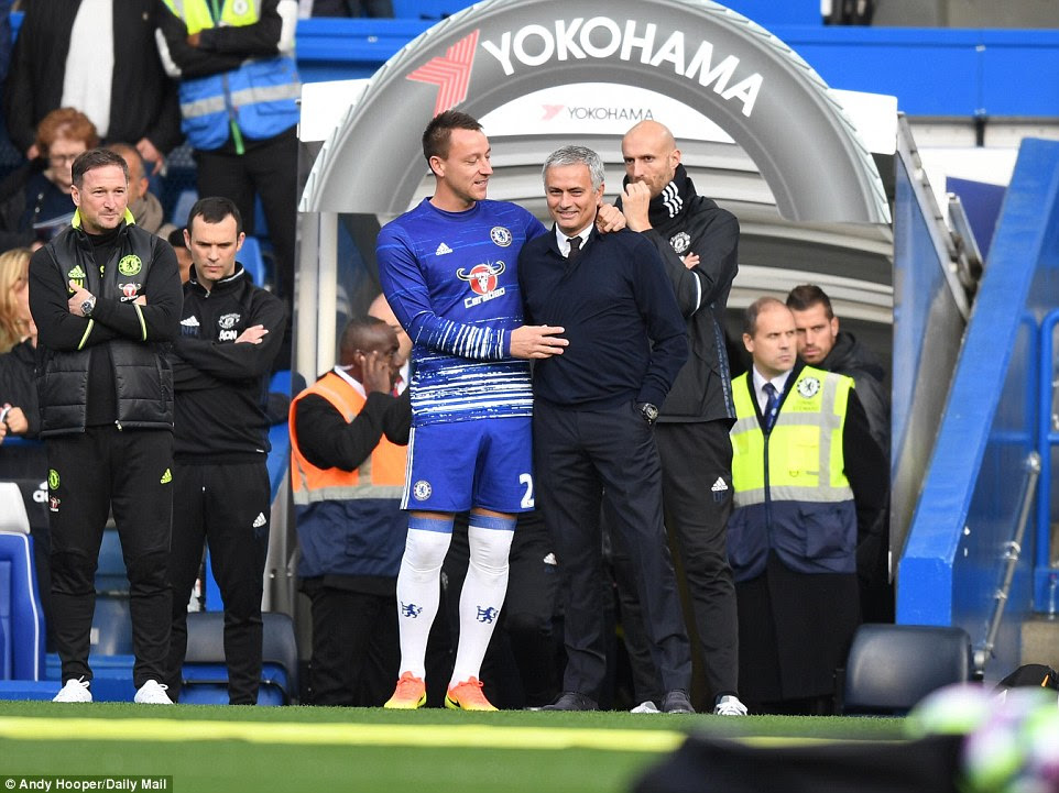 John Terry (centre left) shares a moment with Mourinho as the Portuguese manager returns to Stamford Bridge