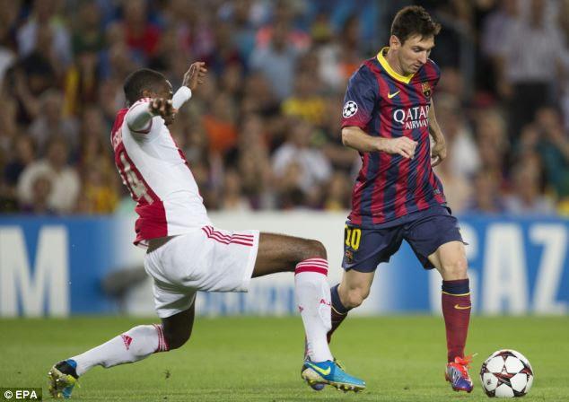 Easy: Messi dribbles past defender Stefano Denswil