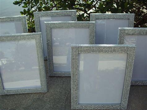 rhinestone frames for table numbers.   Wedding DIY