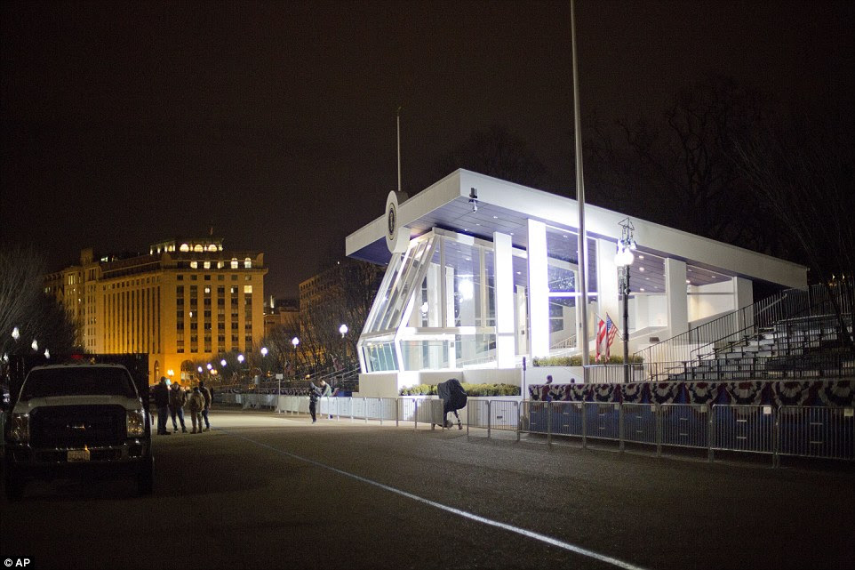 The newly sworn-in President Trump will watch his Inagural Parade from this covered structure outside of the White House. It's pictured above before dawn on Friday