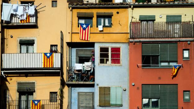 Pro-independence flags hang from balconies in Girona, Spain
