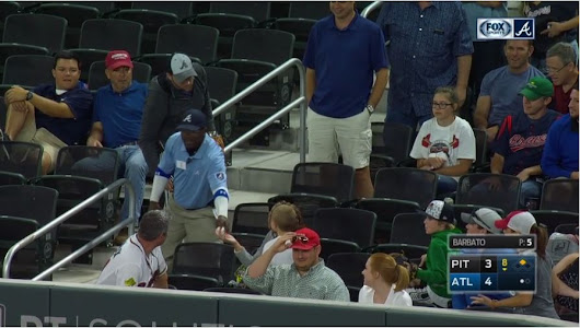 Security guard snatches ball from kid at Braves game