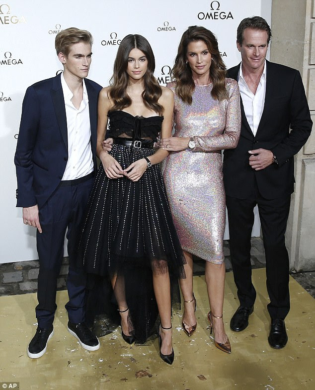 The first family: Kaia Gerber continued to take the style world by storm on Friday as she hit the -Paris Fashion Week Omega Her Time bash alongside her supermodel mum Cindy Crawford, 51, model brother Presley, 18, and their businessman Randy, 55