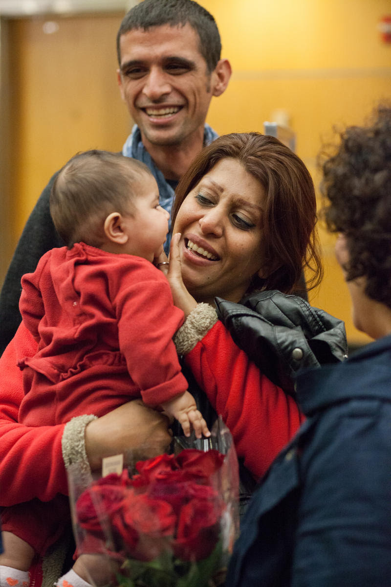 A refugee family from Iran arrives at SeaTac Airport in 2015