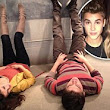 Selena Gomez shares 2am snap of her lying next to on-screen love interest... as Justin Bieber 'chats up' Victoria's Secret models