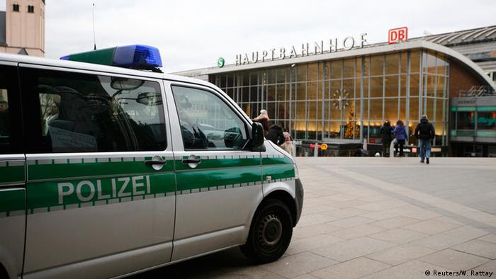 A police vehicle patrols at the main square and in front of the central railway station in Cologne, Germany,
