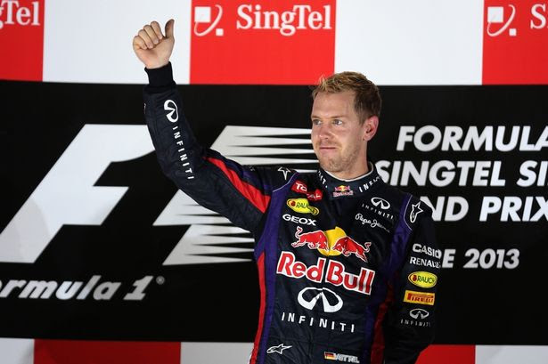 Singapore slinger: Sebastian Vettel celebrates yet another win