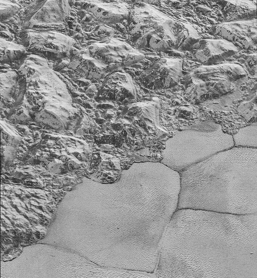 great blocks of Pluto's water-ice crust