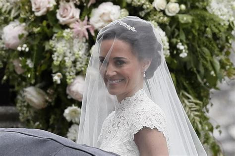 stunning bride pippa  groom james matthews arrive