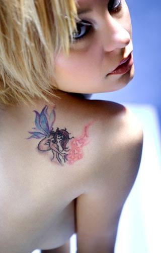 http://www.freetattoodesigns.org/images/tattoo-gallery/female-fairy-tattoo.jpg