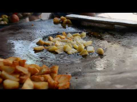 Cooking Aaloo Chaat in an Indian street food shop