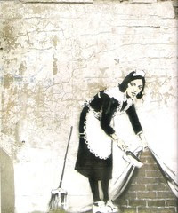 Banksy_woman_with_dustpan_2