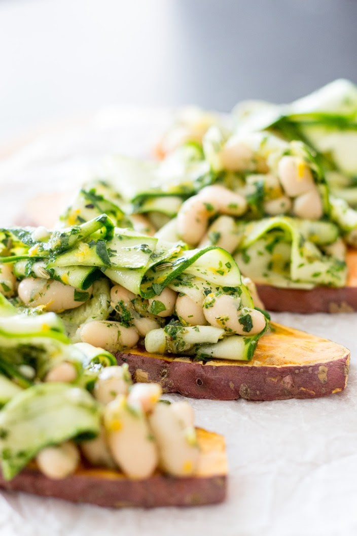 Sweet potato toast with herby cannellini beans and zucchini ribbons.