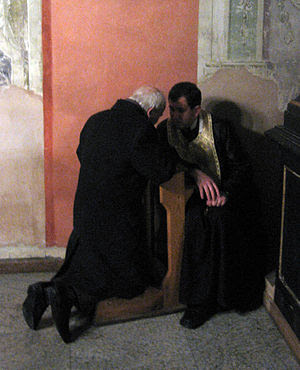 A penitent confessing his sins in the former L...
