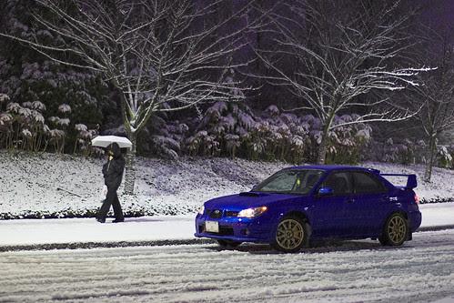 Pedestrian and Subaru in the snow