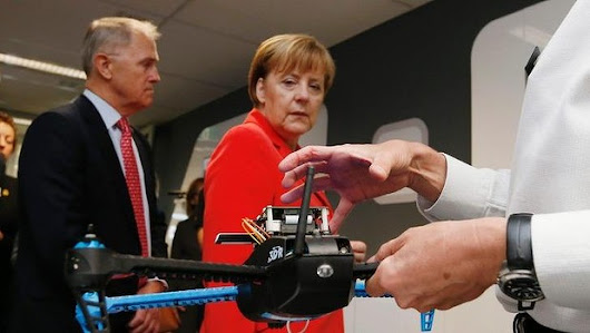Awkwardness in Sydney as Angela Merkel visits victim of federal government's research funding cuts