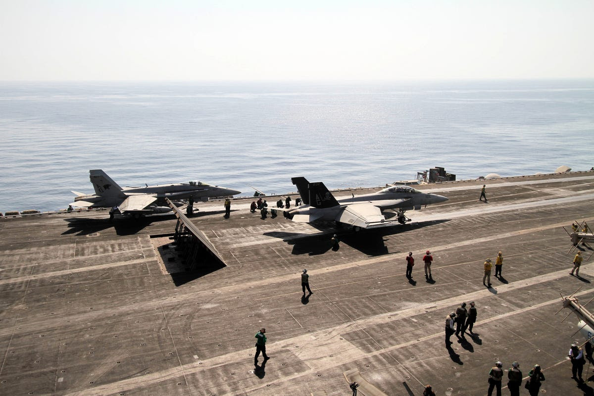 "We took this picture from ""Vultures Row,"" overlooking the flight deck as it sends F/A-18s on patrol over the Persian Gulf."
