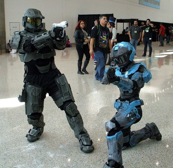Two fans dressed up as Spartans from the Xbox video game HALO strike a pose at Stan Lee's Comikaze Expo in downtown Los Angeles, on November 2, 2013.