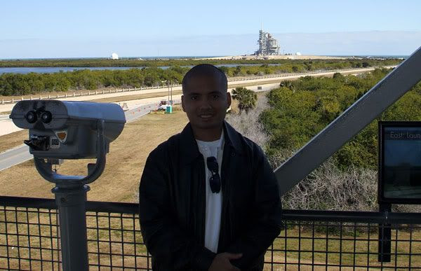Posing with space shuttle Discovery behind me, on February 8, 2009.