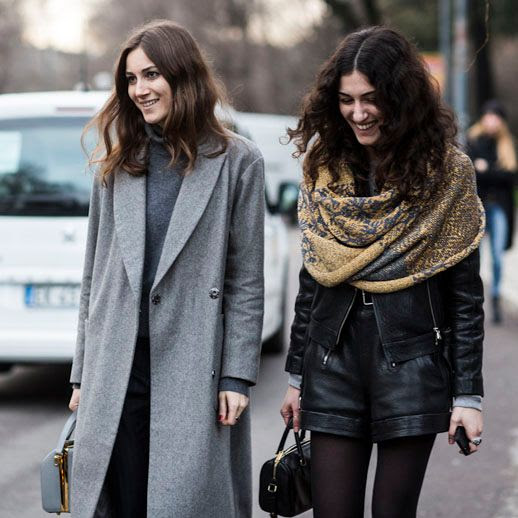 LE FASHION BLOG STYLISH SISTERS GIORGIA AND GIULIA TORDINI MILAN FASHION WEEK STREET STYLE WAVY EFFORTLESS HAIR GREY TURTLENECK GRAY LONG COAT GOLD AND NAVY INFINITY SHOULDER SCARF LEATHER MOTO JACKET CUFFED LEATHER SHORTS TIGHTS MINI SATCHEL BAG CURLY HAIR BEAUTY SMILES RED NAILS MANICURE ITALIAN DESIGNERS FASHION CONSULTANT VIA SANDRA SEMBURG A LOVE IS BLIND 2 photo LEFASHIONBLOGSTYLISHSISTERSGIORGIAANDGIULIATORDINI2.jpg