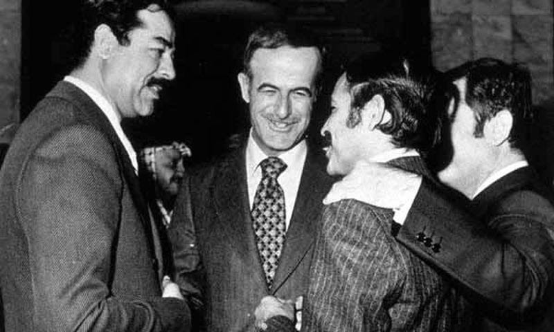 Syrian President Hafez al-Asad (centre) with Iraqi Vice President Saddam Hussein (left), Algerian Foreign Minister Abd al-Aziz Bouteflika (right), and Syrian Vice-President Abd al-Halim Khaddam (far right, half-covered) at Arab League Baghdad Summit. -Source: The Online Museum of Syrian History