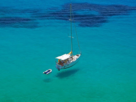 Boats-Fly-Over-Crystal-Clear-Water-4