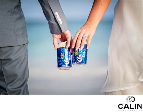 Bride and Groom Holding Beers on a Beach   Wedding