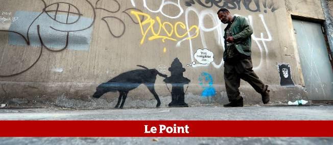 """Pochoir de Banksy à New York, dans le cadre de la résidence """"Better Out Than In"""", 3 octobre 2013."""