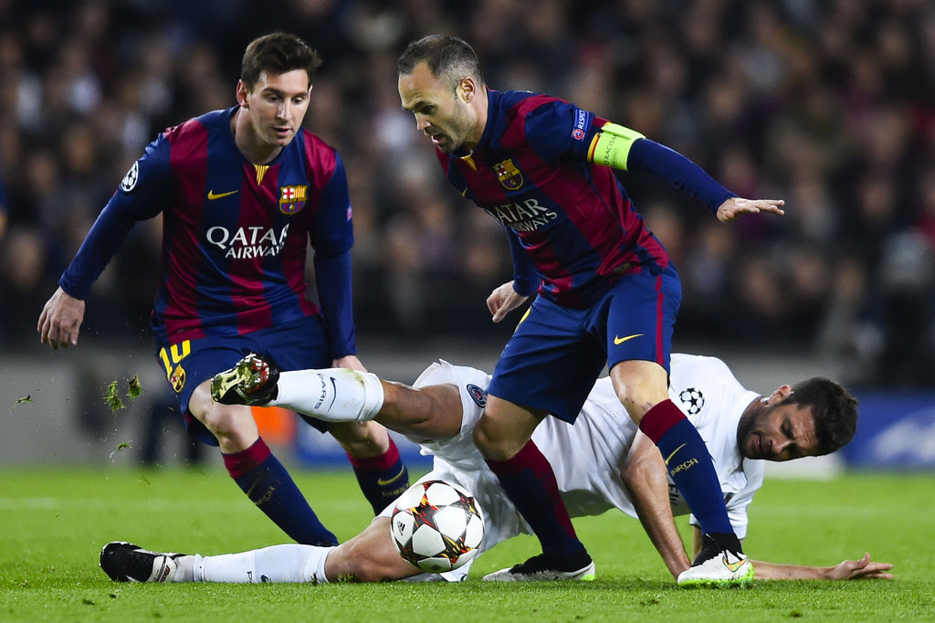 Iniesta and Messi in action for Barca