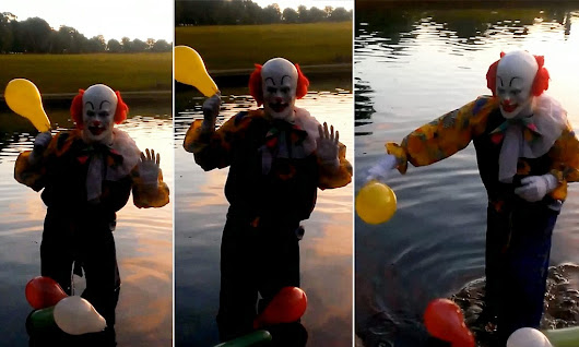 First video footage of mysterious Northampton Clown shows sinister jester emerging from a LAKE in full make-up and fright wig
