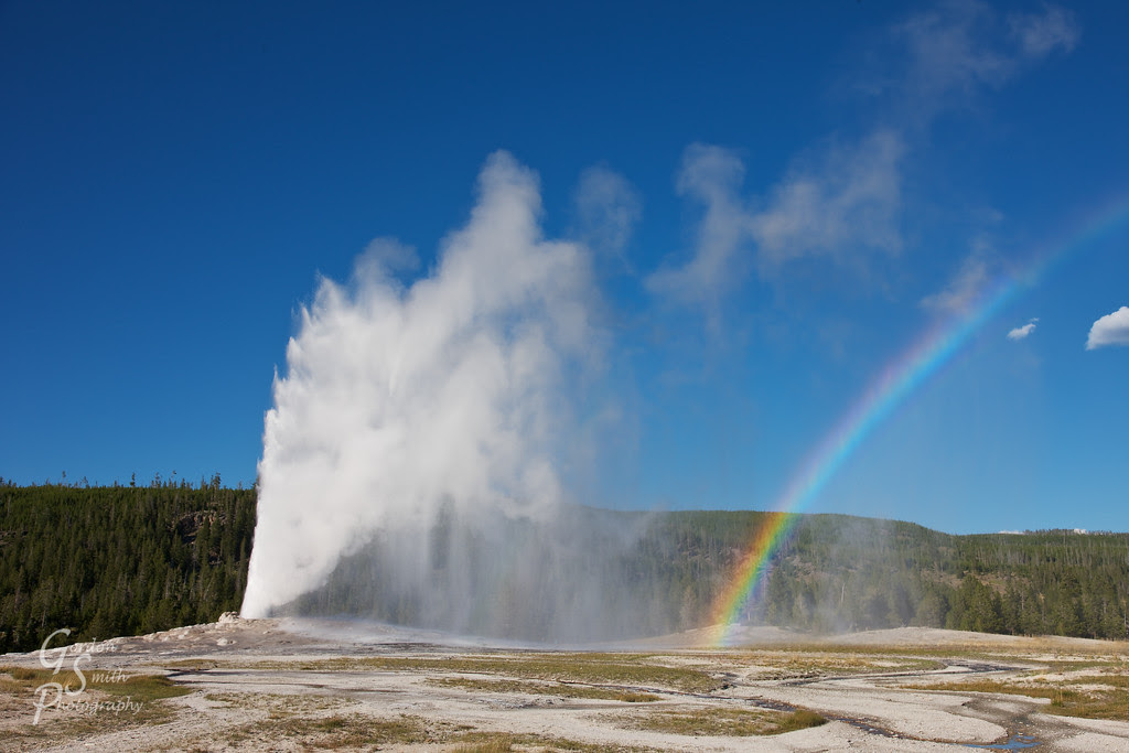 rainbow at old faithful geyser eruption