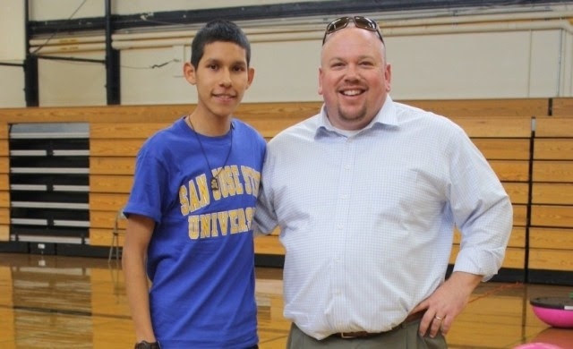 Abraham Lincoln High School Principal Matthew Hewitson (right) says Lincoln High students have completed hundreds of projects over the course of three years.