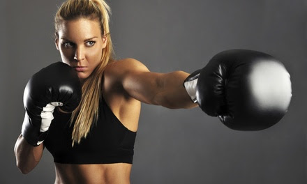 One Month of Kickboxing or 10 Drop-In Kickboxing Classes and Hand Wraps at Shodan Kickboxing (Up to 84% Off)