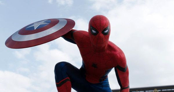 Spider-Man (Tom Holland) poses with Captain America's shield in CAPTAIN AMERICA: CIVIL WAR.